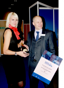 Andrew Porter, UBM presents Dina Beeney with the award.